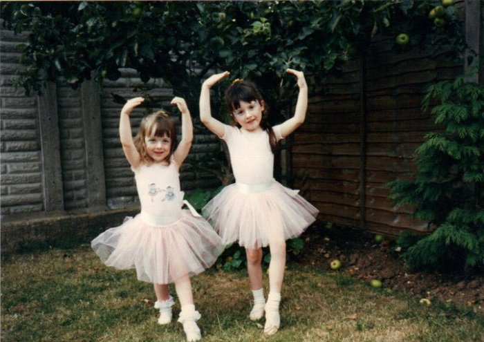 My sister and I becoming well trained business women. In the garden. She is a lot taller than me now.